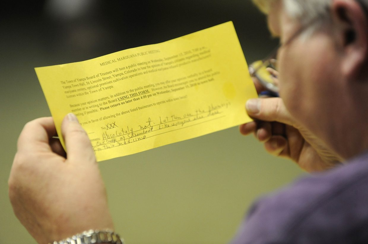Yampa Town Clerk Janet Ray reads an opinion from a Yampa resident who is against medical marijuana during a Sept. 15 public meeting.