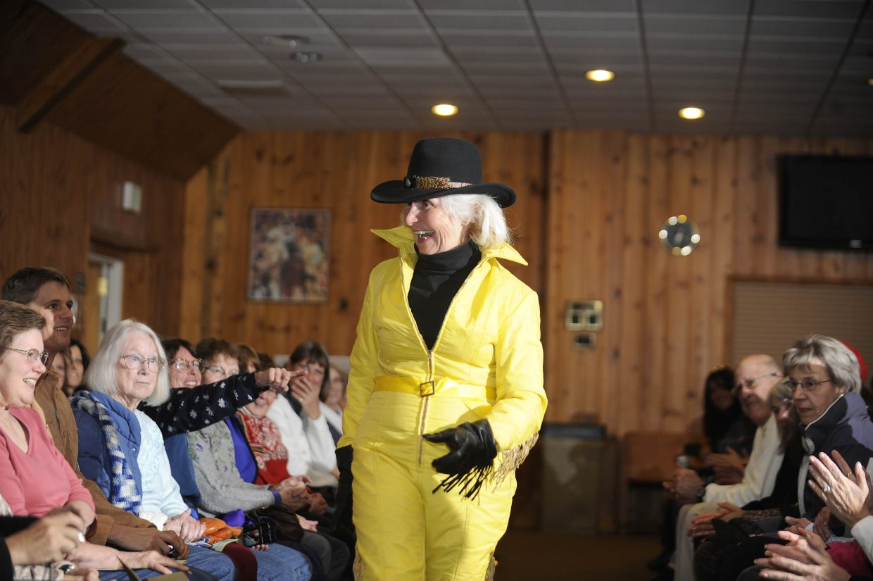 Ann Ross shows off a yellow number at the vintage ski fashion show.