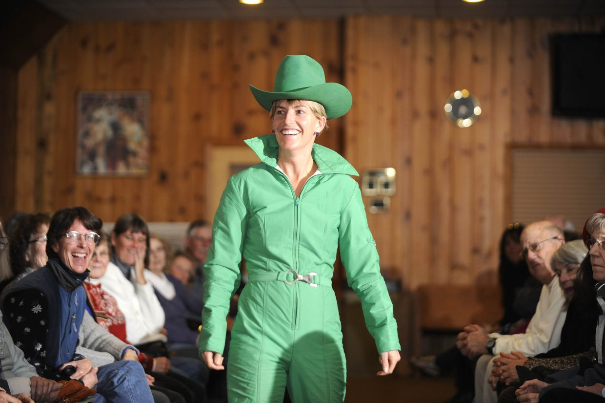 Tiffany Leeson models a green one-piece for the crowd at the ski fashion show organized by the Tread of Pioneers Museum.