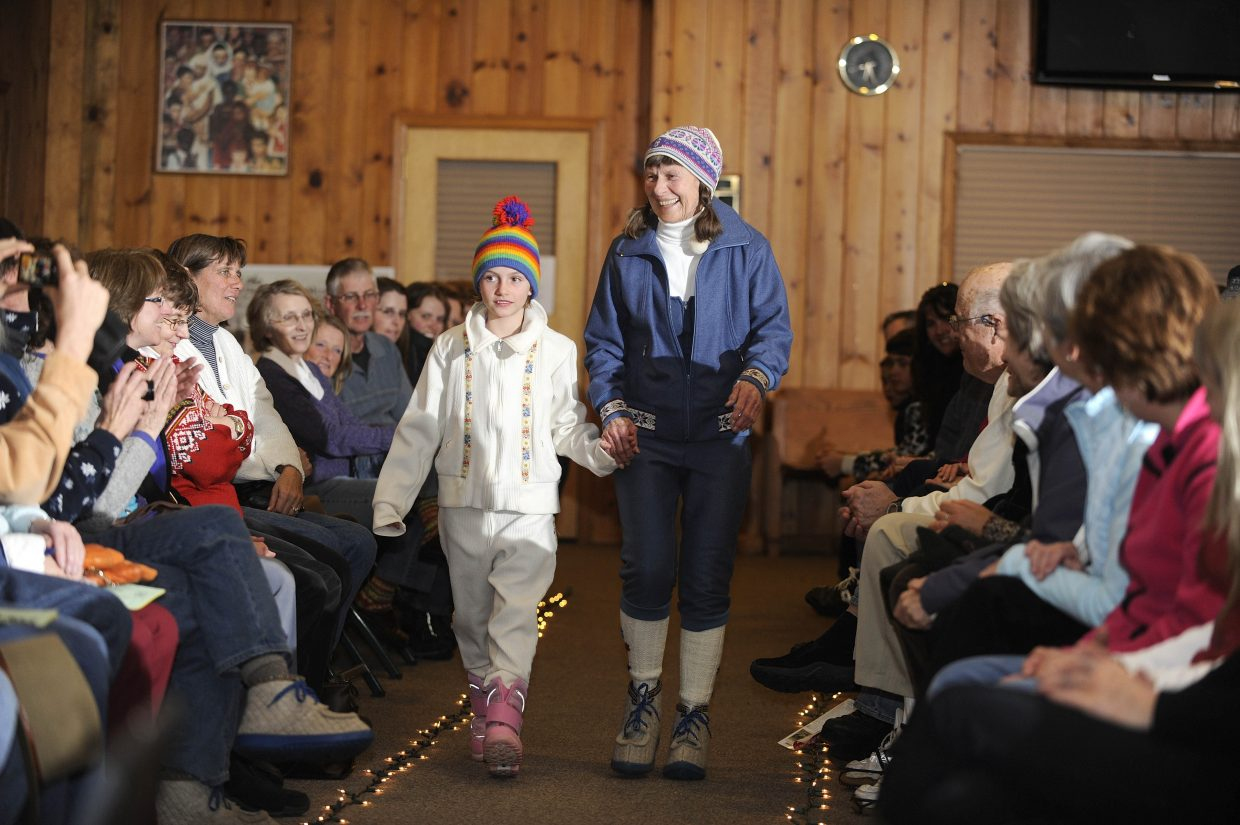 Sophie Leeson, left, and Rossi Jones take a trip down the runway in vintage ski fashion.