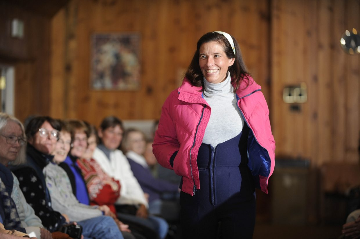 Kappie Emery rocks a bright pink coat at the Tread of Pioneers Museum's Vintage Ski Fashion Show.