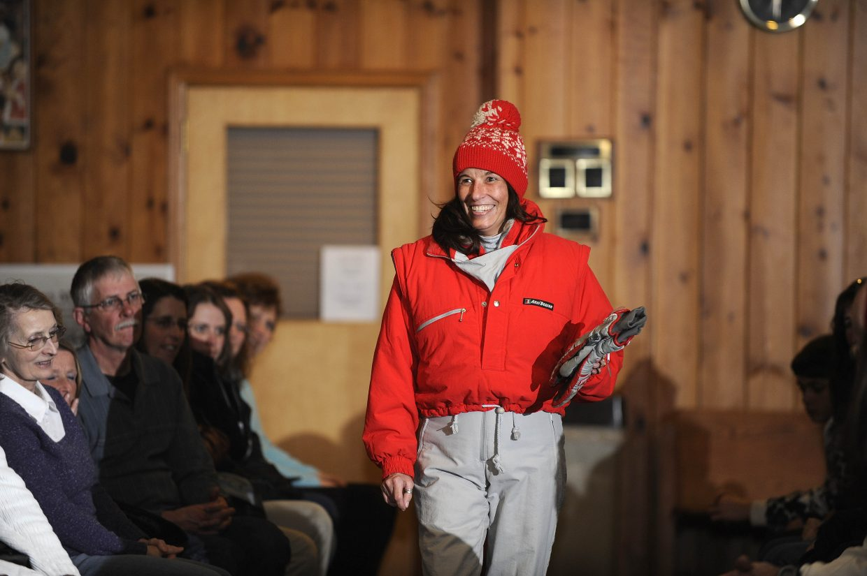 Kappie Emery models a bright red vintage outfit that's sure to be visible on the slopes.