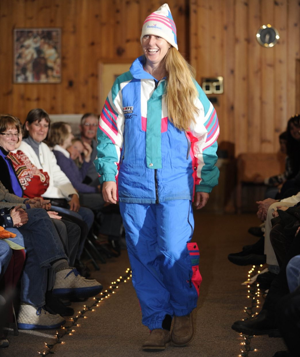 Christina Gumbiner is a vision in neon at the vintage ski fashion show Thursday.