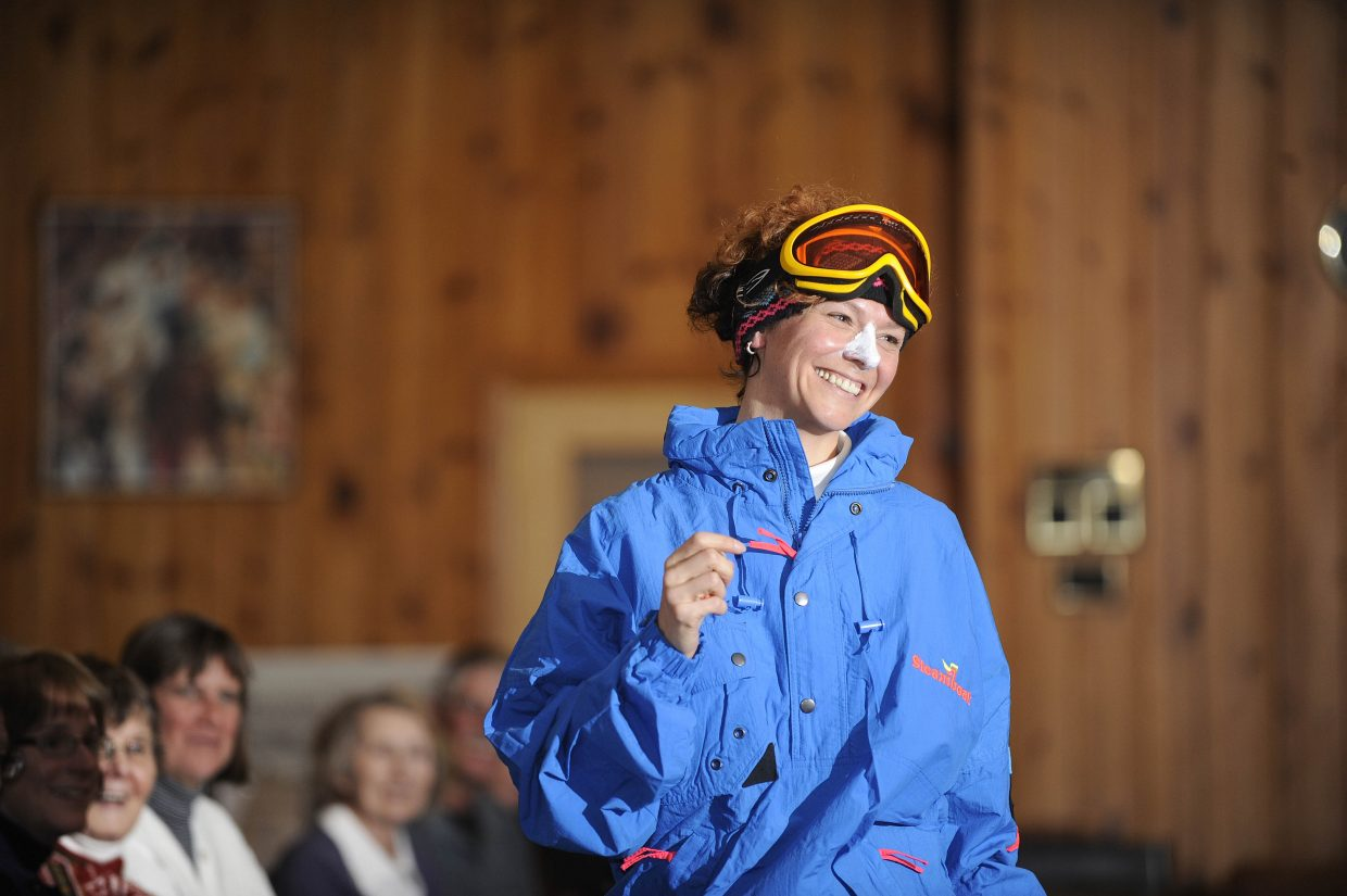 Katy Taylor models a Steamboat Ski and Resort Corp. jacket from the 1990s complete with sunblock on her nose.