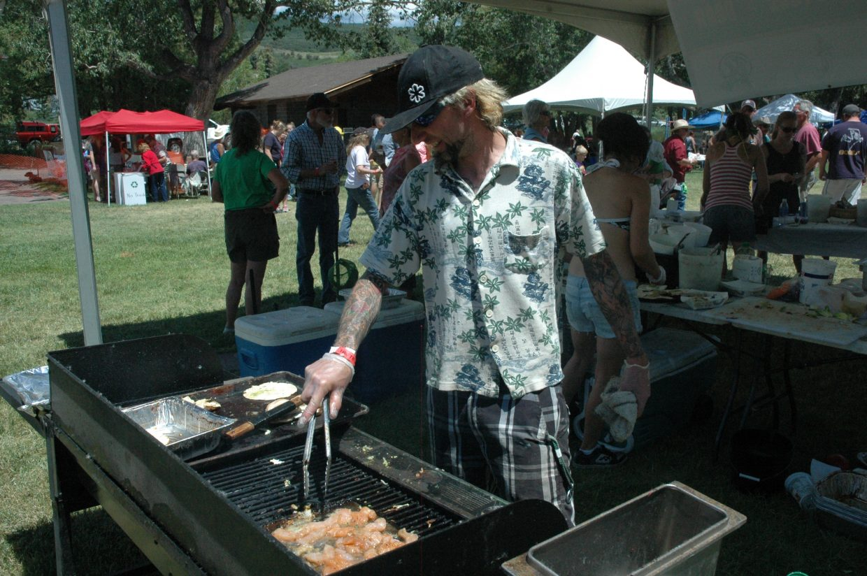 Lupita's Cantina owner Lawrence Jaconetta cooks up some fish for fish tacos Saturday at the Taste of South Routt.