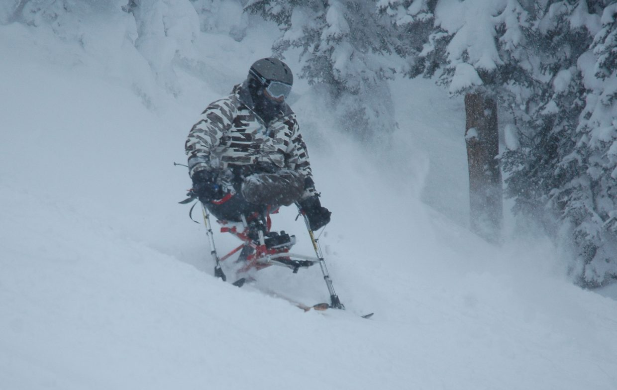 Berthoud's Nikko Landeros skis down Buddy's Run at the Steamboat Ski Area on Saturday at the first day of the All Mountain Ski Camp for Wounded Warriors and People with Disabilities.