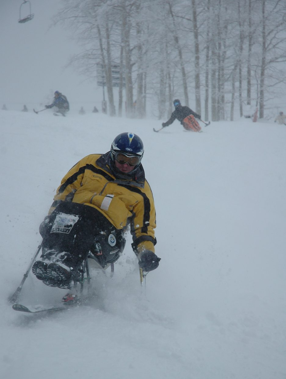Daniel Badiu makes some turns down Rainbow trail at the Steamboat Ski Area at the first day of the All Mountain Ski Camp for Wounded Warriors and People with Disabilities.