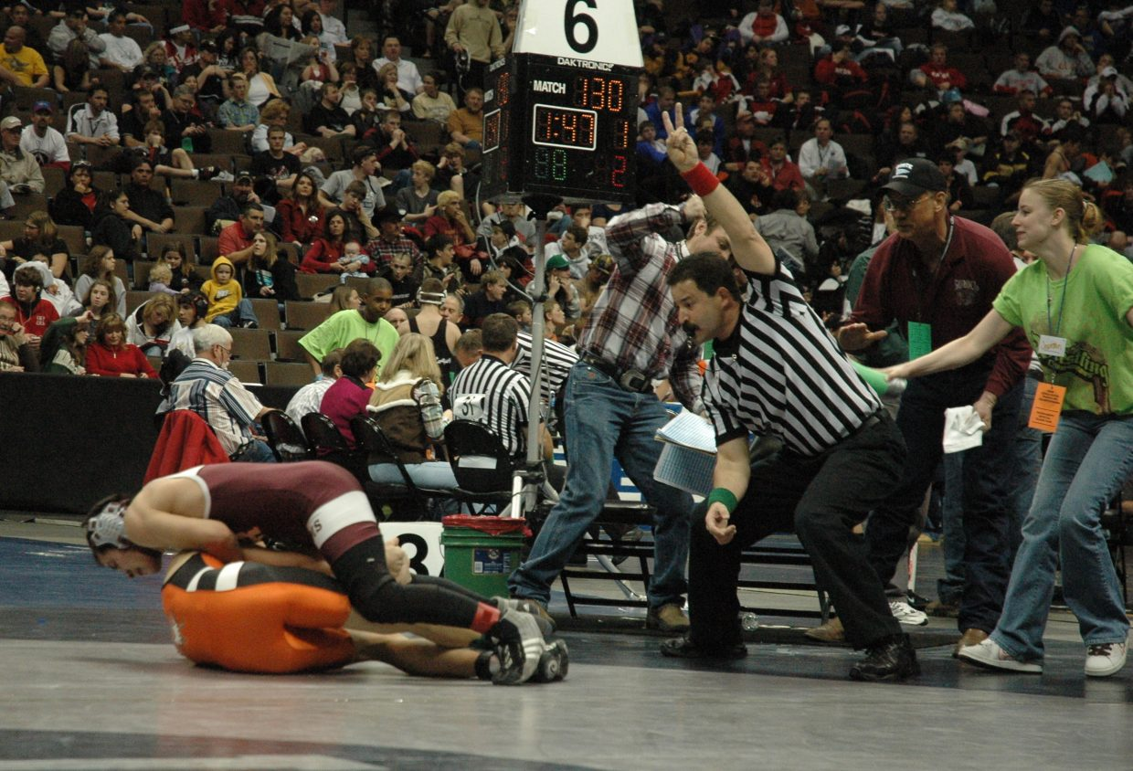 Soroco junior Levi Gonzales scores two crucial, last-second takedown points to send his Friday state championship quarterfinal with Wiggins' Dillon McCombs into overtime (where Gonzales won) as the timing assistant taps the referee and regulation time expires.