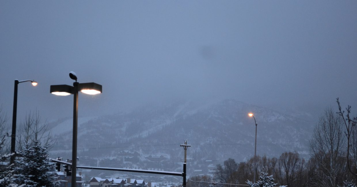 A rare sight: Snow falling so you can barely see the mountain. Submitted by: Amy Johnson