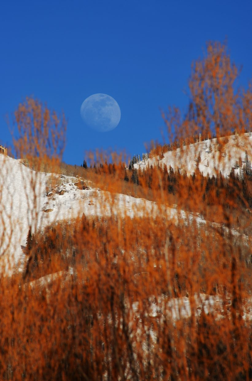 Three-quarter moon rising over ski mountain on March 5. Submitted by: Rebecca Musso