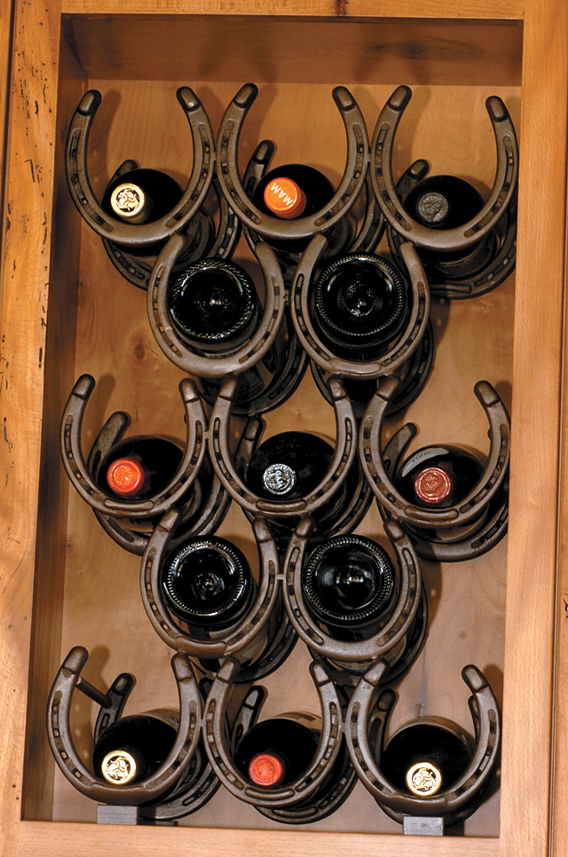 The wine rack, fashioned from welded horseshoes, adds a Western touch.