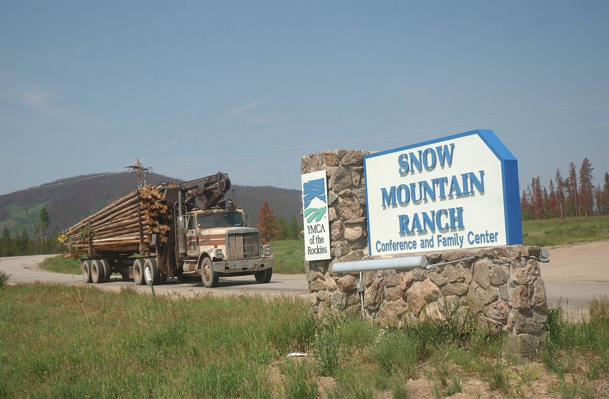 A log truck pulls out of YMCA of the Rockies' Snow Mountain Ranch near Granby, which was devastated by the pine beetle.