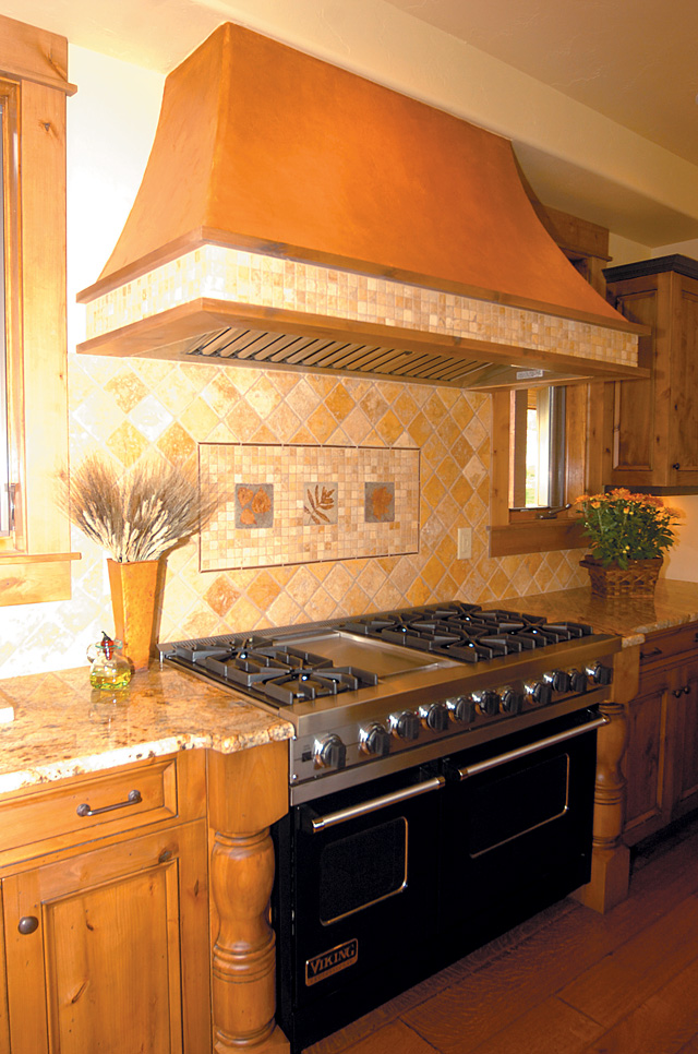 Melinda Miller of Embellishments in Steamboat Springs custom built the faux copper range hood. She applied many layers of tint to arrive at the final metallic look.