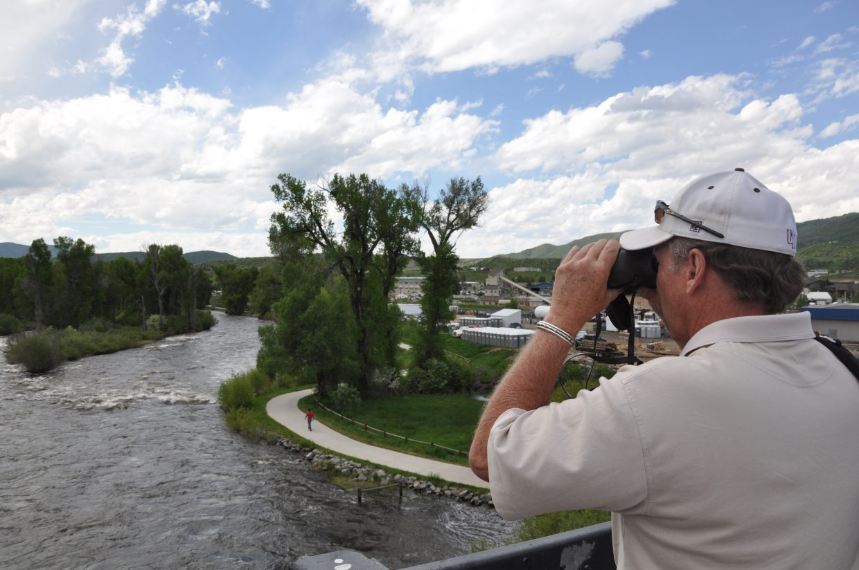 Routt County Office of Emergency Management Director Bob Struble looks downstream from the James Brown Soul Center of the Universe Bridge on Wednesday as crews searched for a man in the Yampa River.