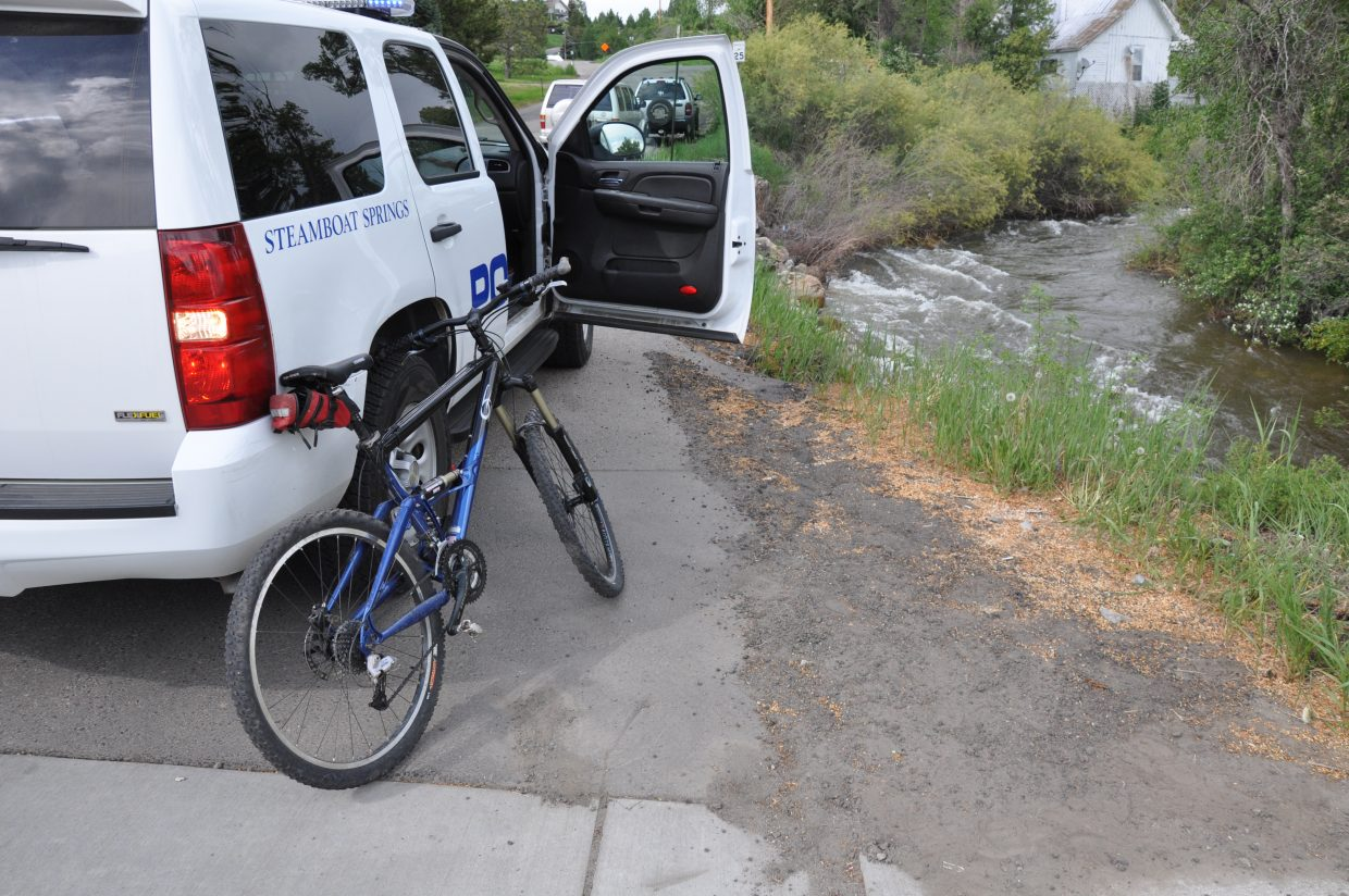 Steamboat Springs Police Department officers responded to 12th Street and Lincoln Avenue at Soda Creek, where a man fell into the creek while trying to get on his bike. Police would not say whether the bike leaning against the police vehicle belonged to John Christopher Noonan, the man who fell in.
