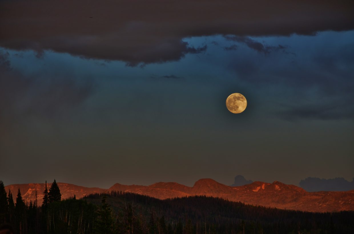 Super Moon 2013 rises majestically over the Zirkels, as seen from the Steamboat Lake State Park Campground. Submitted by: Rebecca Musso