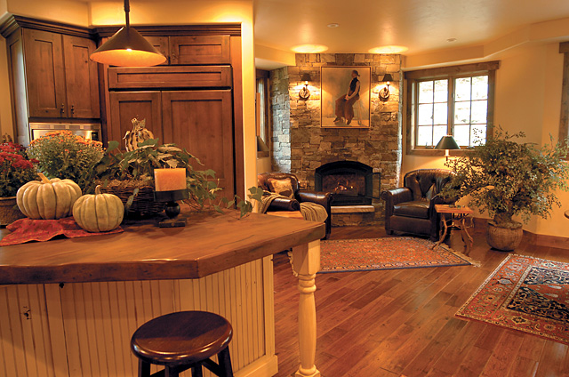 Across the kitchen, Sharp can step around the corner wall that hides the refrigerator and into a reading  sanctuary with two leather chairs bracketing a beautiful stone fireplace.