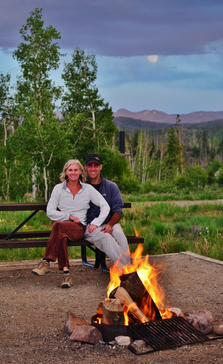 Rebecca & Scott enjoy a cozy campfire while Super Moon 2013 rises behind them after a wicked wind storm and rain at Steamboat State Park Campground. Submitted by: Rebecca Musso