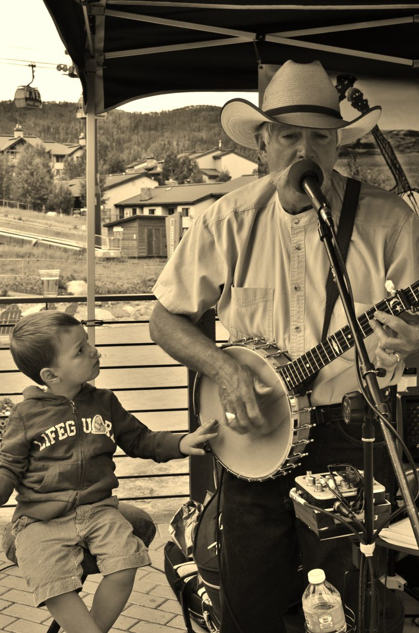 "John Fisher of the Yampa Valley Boys had a ""little picker"" join in at the Sunday performance at Bear River on Sunday. Submitted by Rebecca Musso."