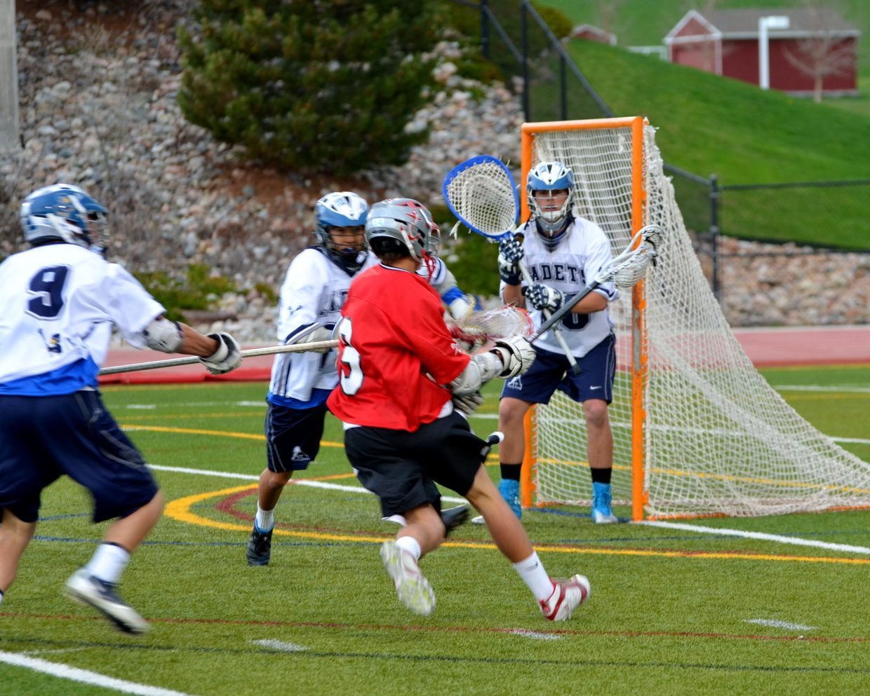 Thomas Tarcha takes a shot in Wednesday's Final Four game against Air Academy.