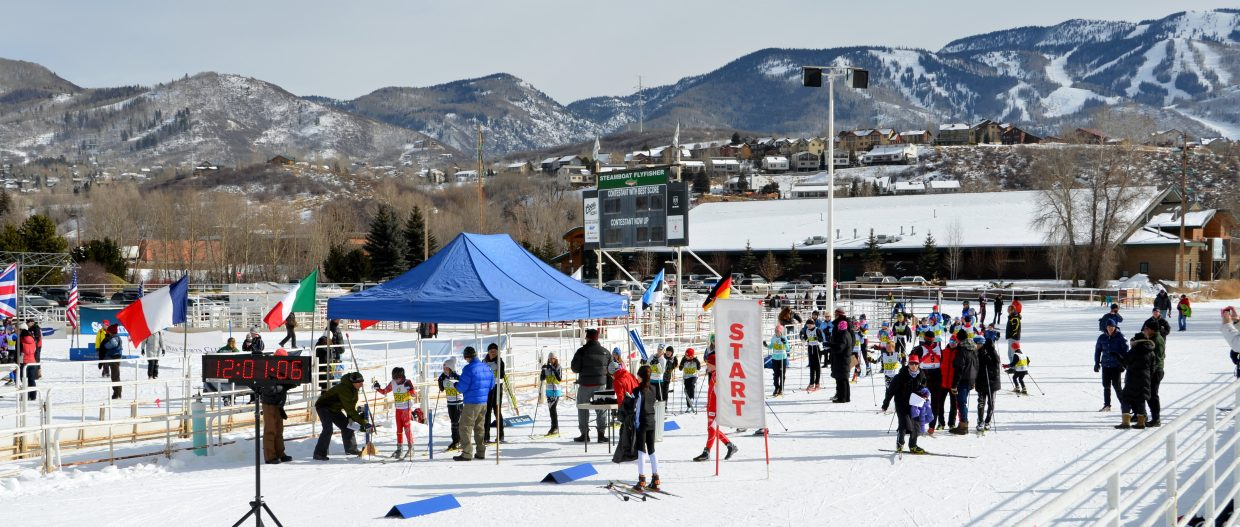 Cross-country skiers get ready to compete at a race at Howelsen Hill on Friday.