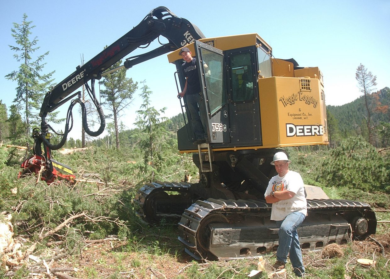 Jerry Heggie with his 20-year-old nephew, Beau, at a logging site.