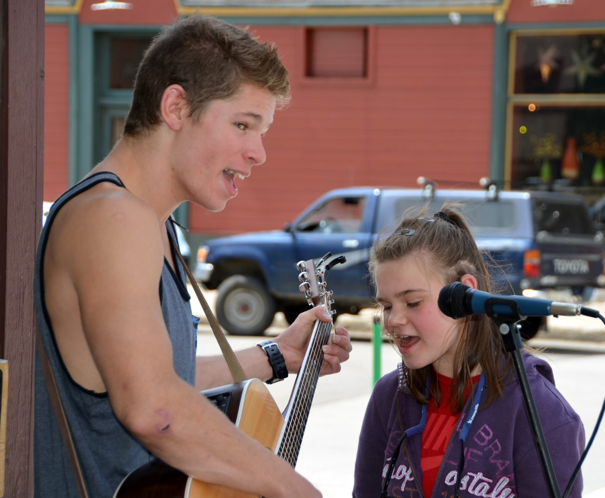 Steamboat Springs High School senior Guerin Lewis entertained the Memorial Day weekend shoppers at the corner of Ninth Street and Lincoln Avenue, by Fuzziwig's. He received a little singing help from eighth-grader Ellie Zwak on a few songs. Submitted by: Shannon Lukens