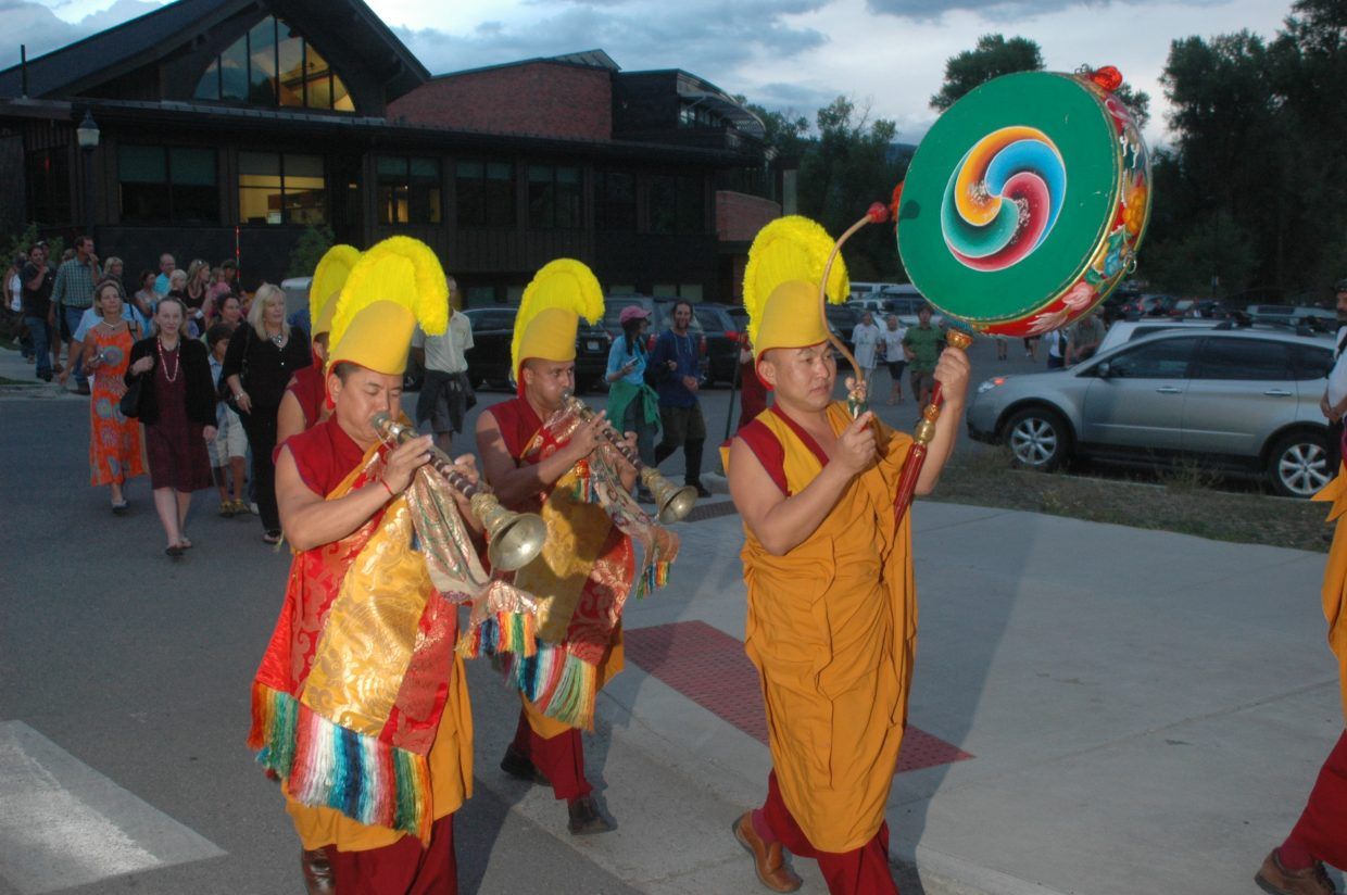 Drepung Loseling monks parade on 13th Street before a riverside ceremony at the Steamboat Spring on Wednesday.