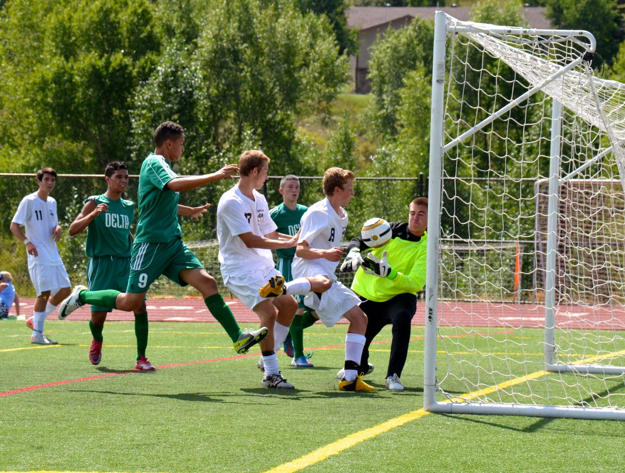 Charlie Beurskens scores a goal in Saturday's Steamboat soccer game against Delta. Submitted by: Jan DePuy