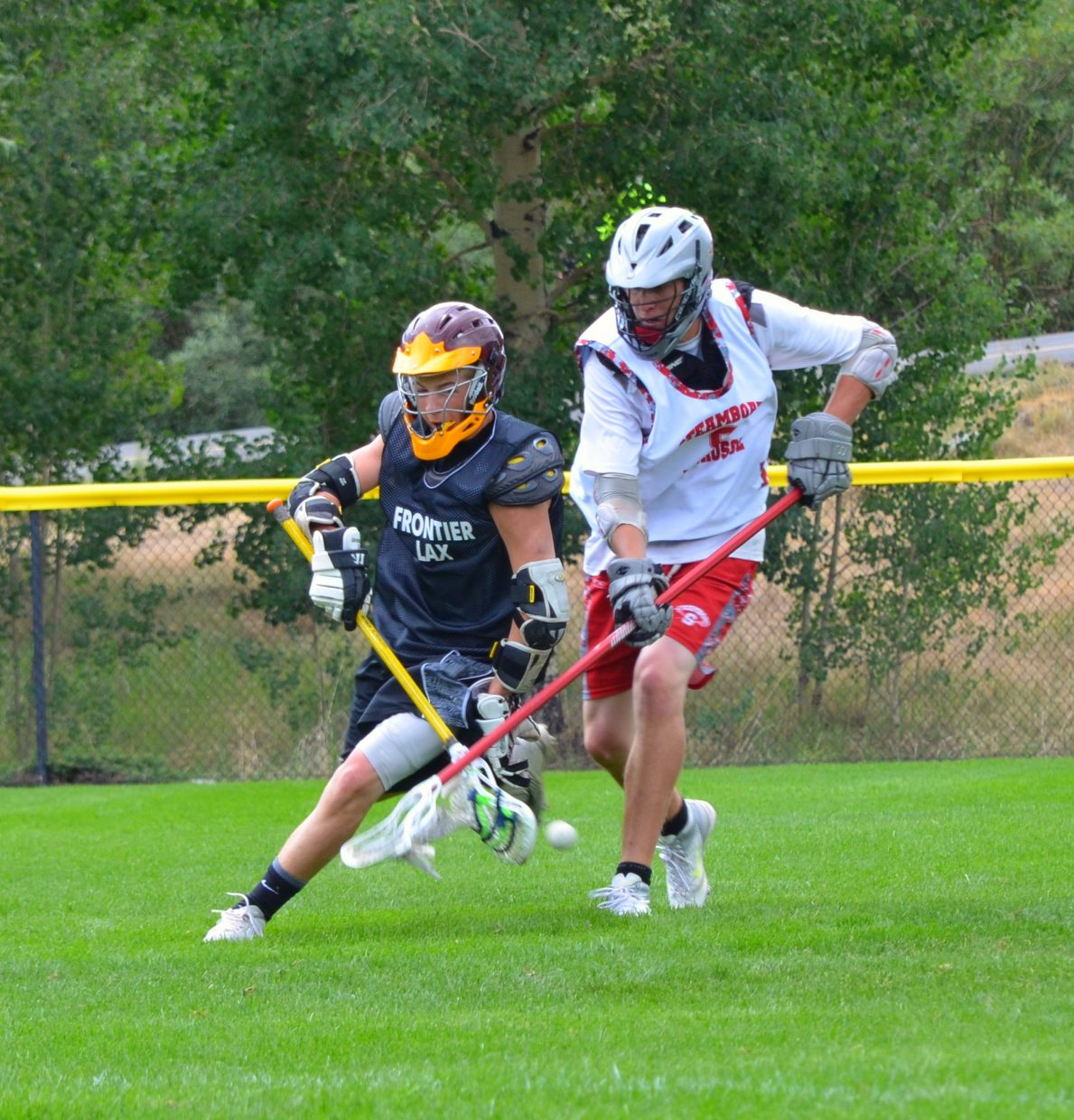 Rising senior Penn Lukens strips the ball from the opposing team at the Summit Lacrosse tournament in Breckenridge this weekend. Submitted by Shannon Lukens.
