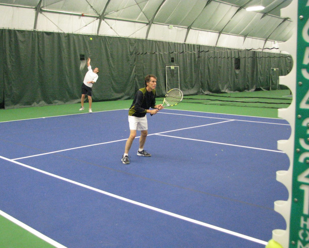 Dave Schaller and Gabri Erspamer compete at the Steamboat City Singles and Doubles Championships on Saturday at the Tennis Center at Steamboat Springs.