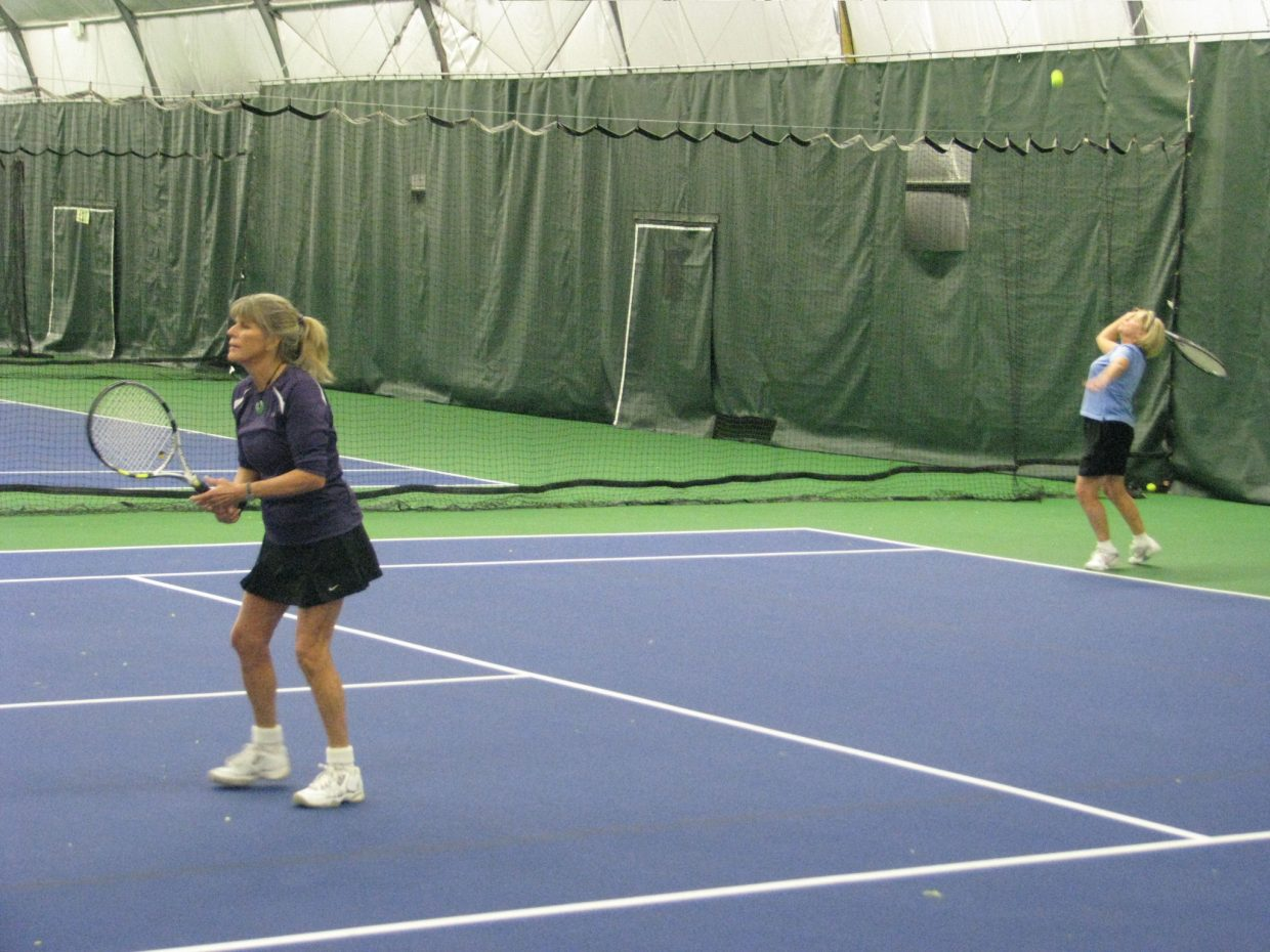 Deb Sill and Bonnie Baggenstoss hit a return Saturday during the 2011 Steamboat City Singles and Doubles Championships. They defeated Jeannie Antonucci and Colleen Grubs in the Women's 4.0 Doubles round robin.
