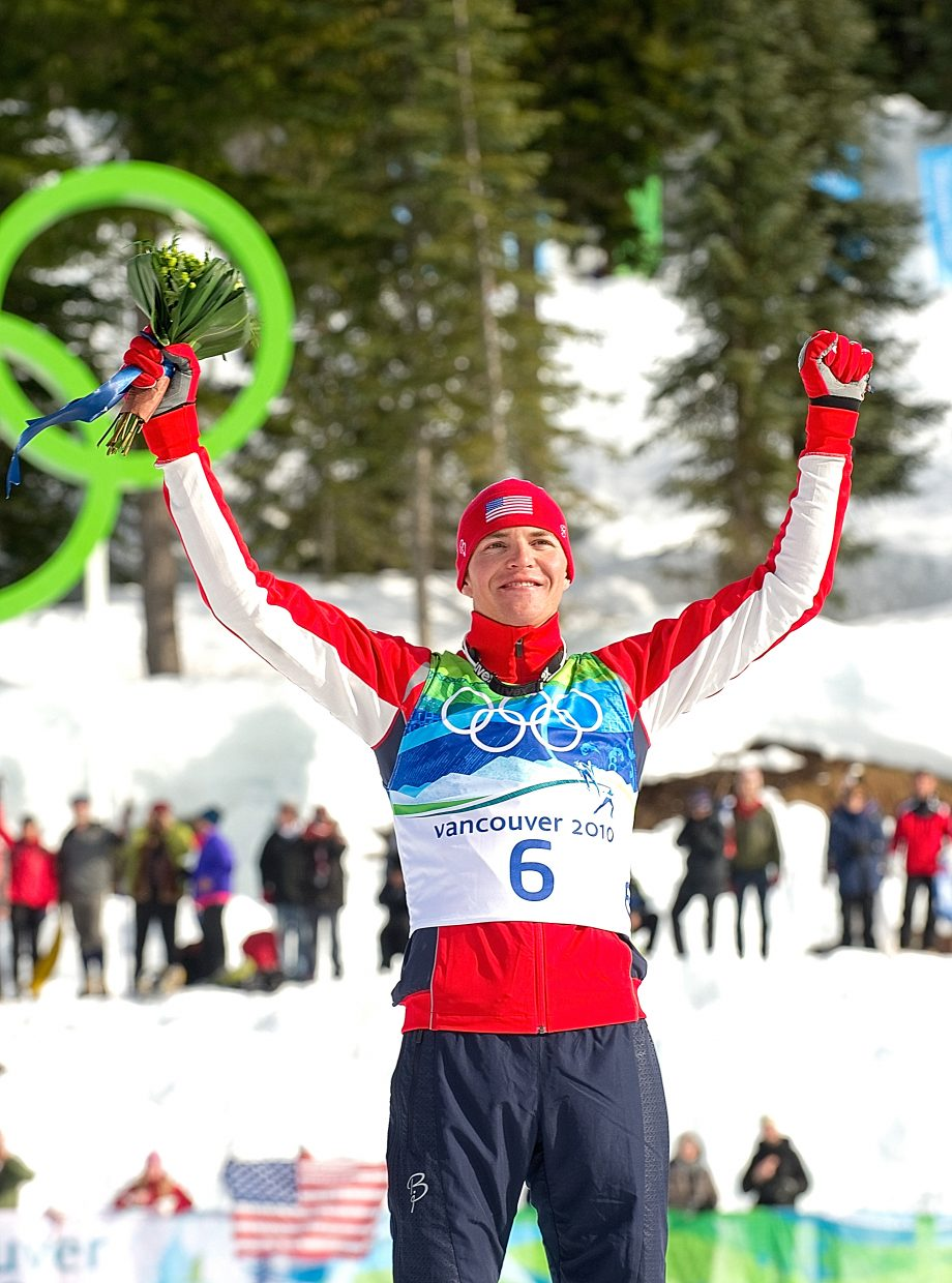 U.S. Nordic Combined Ski Team member Billy Demong, who lived and trained in Steamboat Springs, celebrates his gold medal during the follower ceremony after Thursday's individual large hill competition at Whistler Olympic Park in British Columbia.
