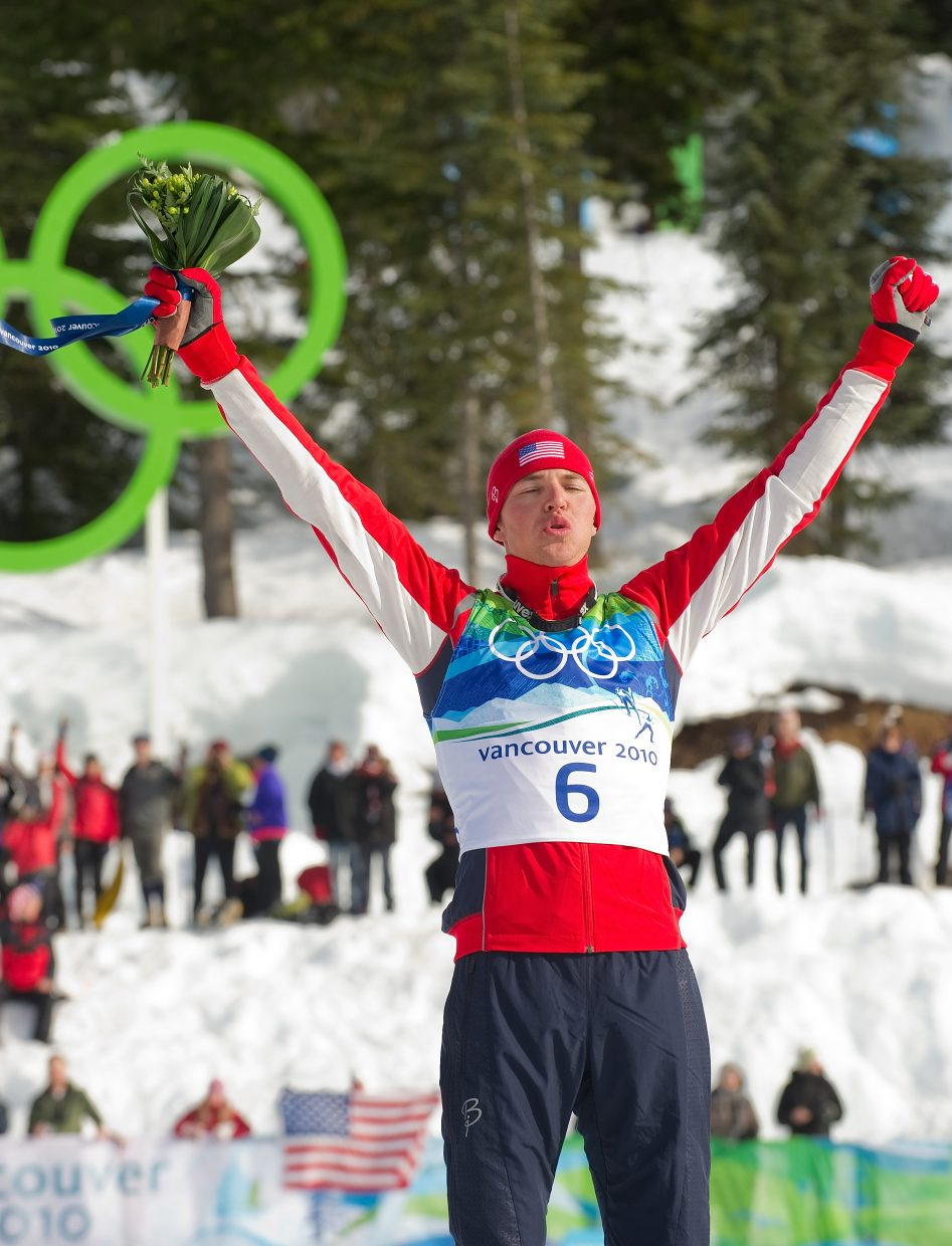 U.S. Nordic Combined Ski Team member Billy Demong, who lived and trained in Steamboat Springs, stands in the gold medal spot during the flower ceremony at Thursday's individual large hill competition at Whistler Olympic Park in Whistler, British Columbia. Demong raced to gold in the event, and teammate Johnny Spillane won silver.