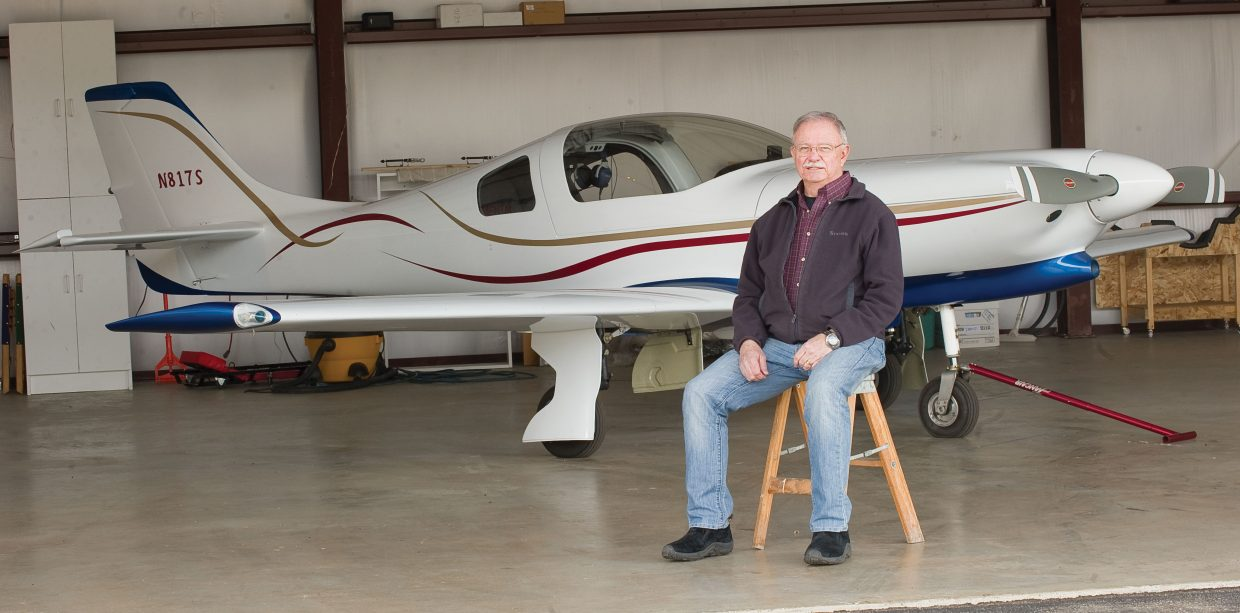 Local pilot Jack Dysart sits in front of the plane he's been buidling for nearly a decade. Dysart built the Lancair 360 from a kit.