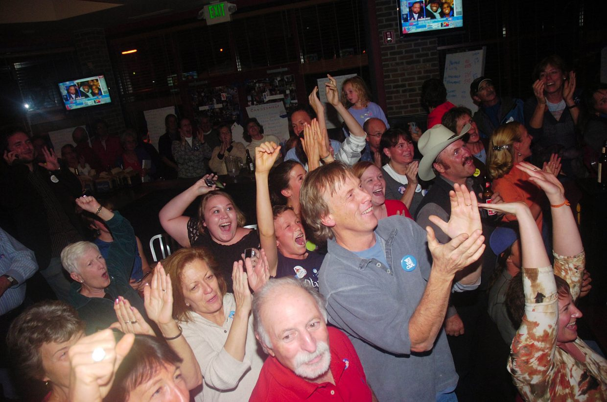 Barack Obama supporters celebrate during a Democratic watch party Tuesday evening at Big House Burgers in Steamboat Springs.