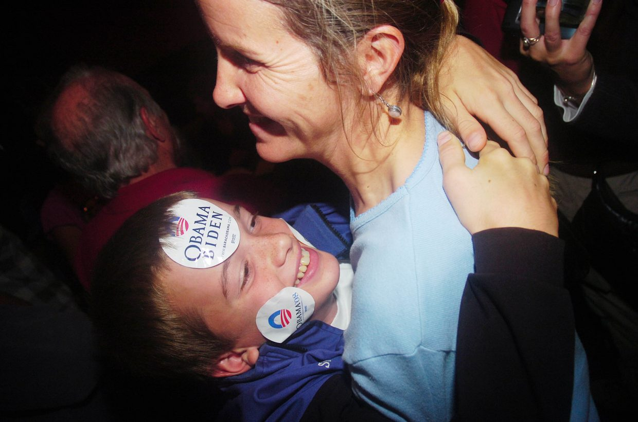 Jennifer Good hugs her nephew, 12-year-old Jasper Good, during a Democratic election party Tuesday night at Big House Burgers in Steamboat Springs.