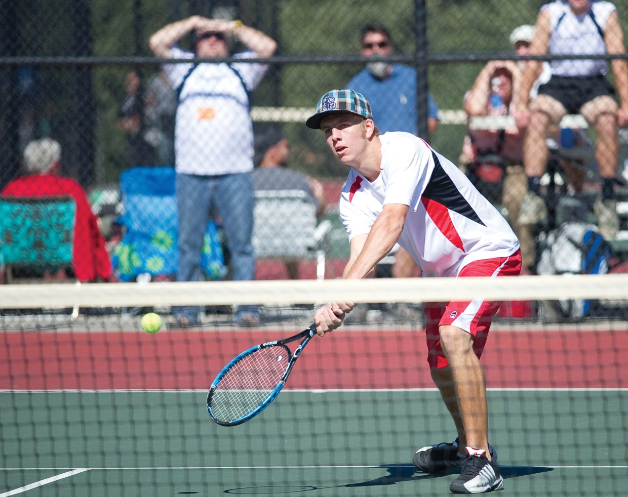 Steamboat Springs Erik Owen returns a shot during a first round of the state high school tennis tournament in Pueblo on Thursday afternoon. Owen and teammate Stefan Sortland were playing in the No. 3 doubles bracket.
