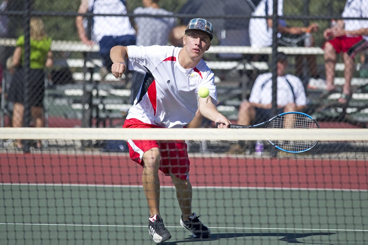 Steamboat Springs Erik Owen returns a shot during the quarterfinals of the state high school tennis tournament in Pueblo on Thursday afternoon. Owen and teammate Stefan Sortland were playing in the No. 3 doubles bracket.