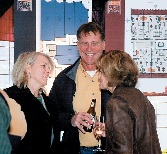 Ruth Dombrowski talks to Jim and Jill Leary at an event hosted by Jim Cook to showcase his new Alpenglow, Howelsen Place and Riverwalk projects.
