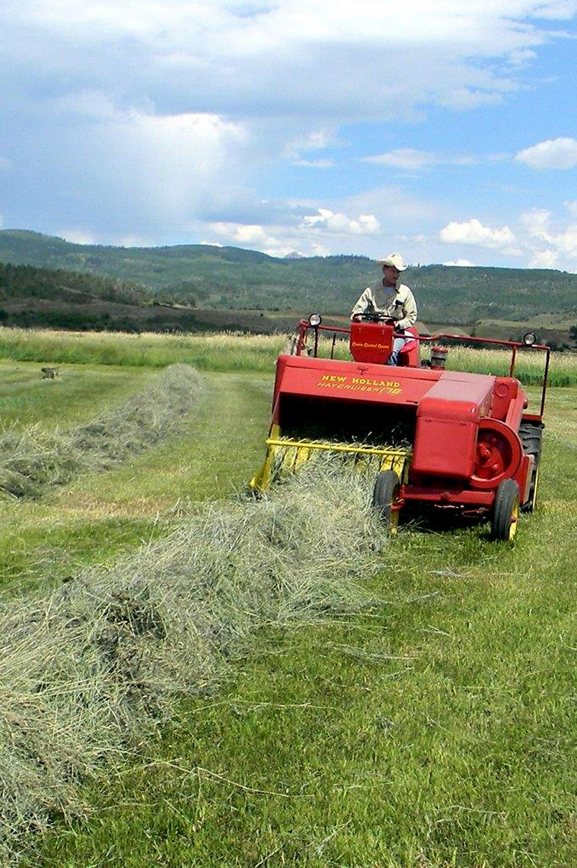 Bill Fetcher restored a 1959 New Holland self-propelled baler that began its service on his family ranch 54 years ago and used it to put up 120 small bales on the Fetcher Ranch near Clark this summer.