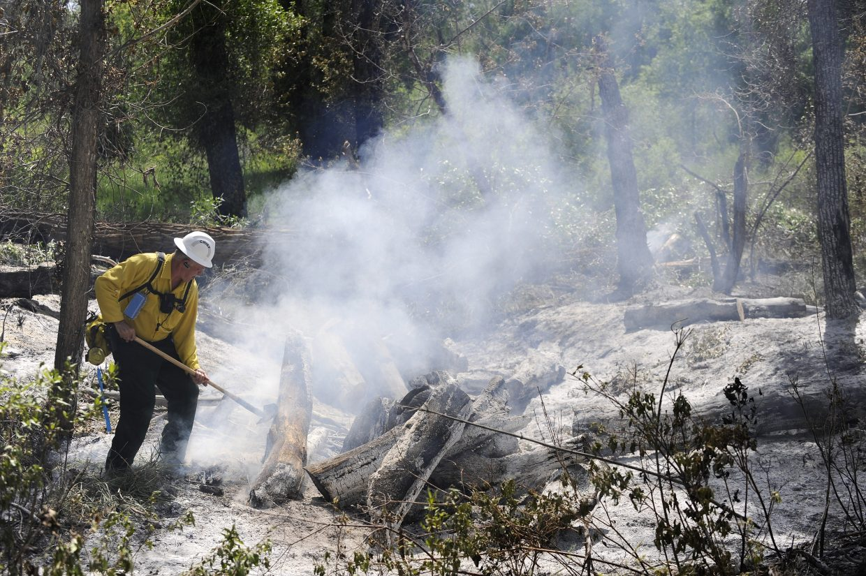 West Routt Fire Protection District Chief Bryan Rickman works at the fire Tuesday.