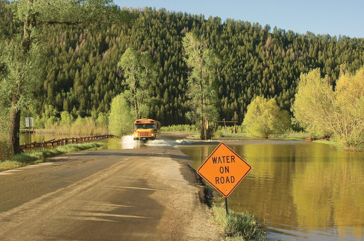 Water from the Elk River was still flowing across Routt County Road 44 west of Steamboat Springs on Wednesday. The water makes travel on the road treacherous for motorists in places and has completely flooded the Saddle Mountain Ranch and several neighboring properties.