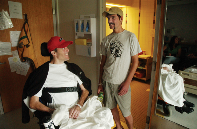 "Dave Genchi, left, and Andrew ""Hondo"" Sanders talk and laugh in Genchi's room at Craig Hospital in Denver. Genchi and Sanders both injured their spinal cords in snowboarding accidents last season in Routt County. Sanders was discharged from the hospital after regaining his ability to walk. Genchi is paralyzed from his chest down and is scheduled to leave the hospital July 10."