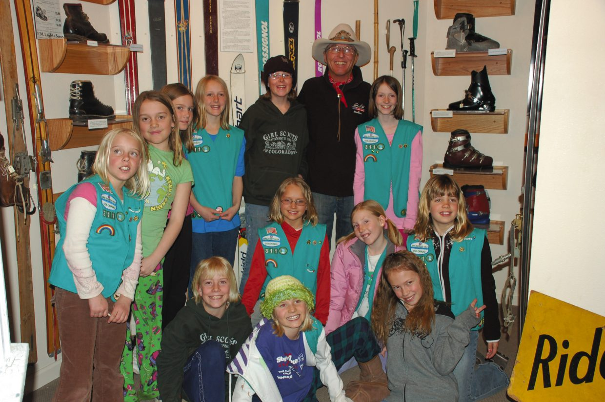 Steamboat's Director of Skiing Billy Kidd met Girl Scout Troop 311 at the Tread of Pioneers Museum on Tuesday and led the fourth-grade girls on a tour through the skiing section of the museum. He was wonderful, signing autographs on ski passes and Girl Scout vests.