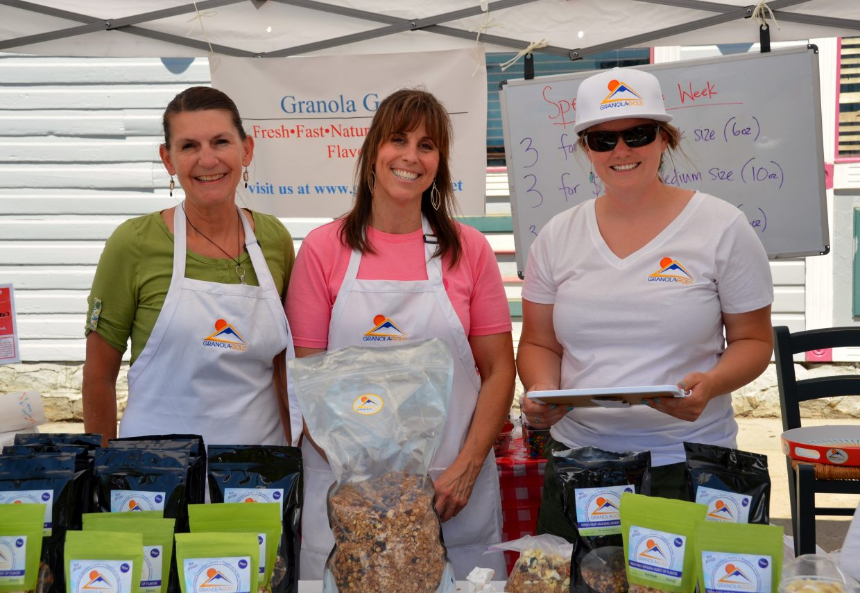 Pam Dapogny, Diane Lekarczyk and Kiersten Ryan work the Granola Gold stand at the Farmers Market. Submitted by: Shannon Lukens