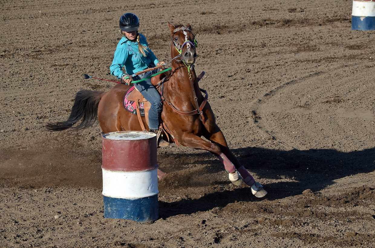 Jewel Vreeman reins her horse, Poker, around the first barrel in the barrel racing phase of the 4-H gymkhana at the Routt County Fair on Monday in Hayden. The pair placed second and went on to win the senior pole bending competition.