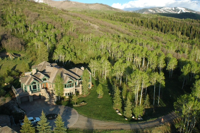 An aerial view of the home in Strawberry Park shows how it is secluded in an aspen forest despite its close proximity to nearby public schools.