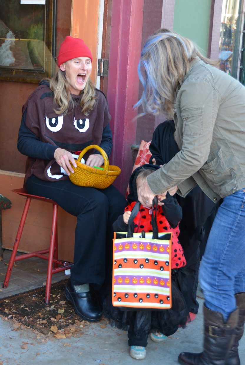 Cindy Arnis serves candy at White Hart Gallery. Submitted by: Shannon Lukens