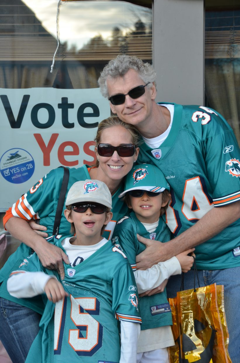 Stephanie, Christopher, Thomas and Bill Faunce support the Dolphins on Halloween night. Submitted by: Shannon Lukens